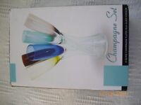 6 glass champagne flutes in glass cooler.Used once.