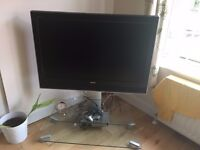 42 inch Toshiba Flat Screen TV and remote. Price includes TV stand