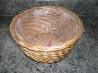 A round wicker plant holder with waterproof liner.