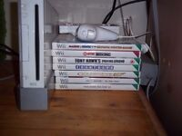 Nintendo wii bundle with controller and 7 games.