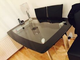 Glass top dinning table and six chairs ,