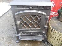 Multi fuel wood or coal burner c/w broken glass