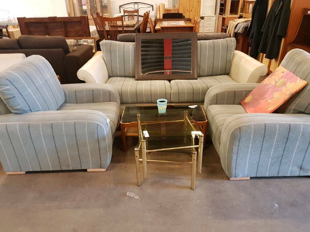 Large striped fabric two seater with two matching armchairs