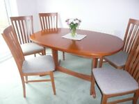 'G' Plan oval extending table with six matching chairs