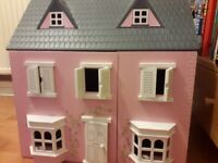 Wooden house for the little people in your family.