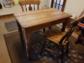 Small solid wood table and chairs