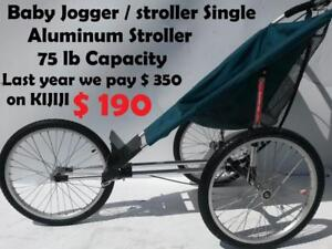 Baby Jogger / stroller Single / Trailer Bicycle  Aluminum Stroller 75 lb Capacity Can hold up to 7 year old kids