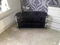 Large black and sliver glass tv stand