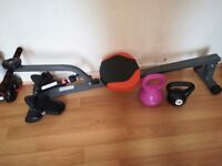 Rowing Machine with Free Kettlebells