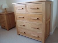 Oak chest of drawers. 2 smaller drawers over 3 large drawers. New and unused.