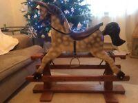 Beautiful Vintage-traditional Rocking Horse on wooden swinging base.
