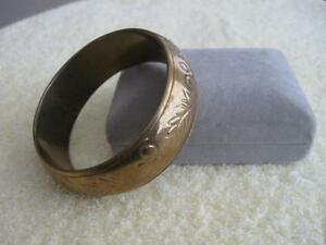 LARGE 10-INCH GOLD-TONE BANGLE-STYLE BRACELET..[EMBOSSED]
