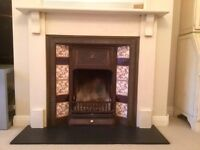 Cast iron and tiled fireplace and wooden mantel surround