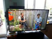 """TECHNIKA 40"""" LED tv slim line with stand and remote"""