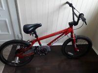 BMX APOLLO BIKE WITH STUNT PEGS AND HELMET