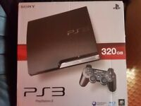 BOXED 320GB PS3 CONSOLE AND 31 GAMES