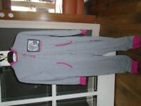 One Direction hooded onesie age 9-10yrs. Good condition.