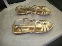 Gold Sandles size 5 tripe e fitting