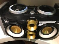 Phillips ipod and iphone boom box with dual rotable docks and crossfdaders barly used