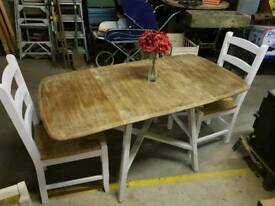 Oak ercol table and 2 chairs