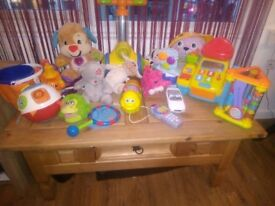 Baby toys, including a rocking horse and a giraffe bike!! Delivery available!