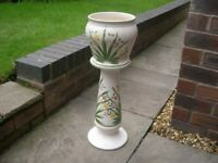 An attractive ceramic jardiniere on stand and with lovely floral design.