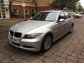 Silver BMW320d with 57 plate