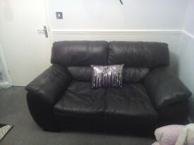 Dfs leather sofa, 2 seater very good condition nice and comfy . only 2 year old