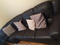Brown leather corner sofa.