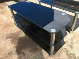 Black tough glass TV stand with silver legs