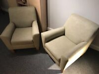 A pair of Next armchairs.