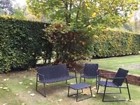 Contemporary garden furniture set in black . Two seater sofa , 2 single chairs and a small table
