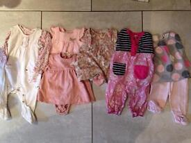 Selection of 3-6 month baby girl clothes.