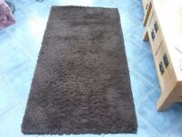 Brown rug and a cream rug with slight pattern in fawn and brown for sale.
