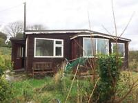 Chalet (2 bed, lounge, bathroom and kitchen) with 10 double glazed windows