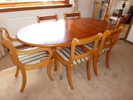 Yew wood extending dining table and 6 chairs.