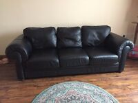 Real Leather 3 and 2 seater Sofa's with extra set of covers.