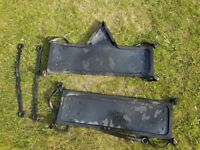 Preowned rubber trade plate holders with fixing straps.