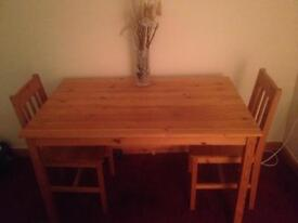 Solid wooden dinning room table & 4 chairs