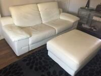 Lovely off white leather settee and large matching footstool (not storage). No marks or scratches.