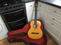 Guitar with Case in Good Condition