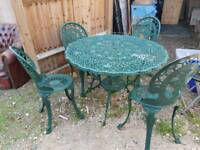 Metal garden table with chairs