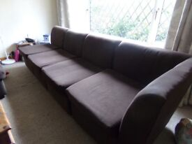 NICE CLOTH BROWN LONG SOFA SPLINTS INTO FOUR NOT A LOT OF MONEY .