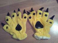 New & Unworn Yellow Claw gloves (they match a yellow pikachu onesie)