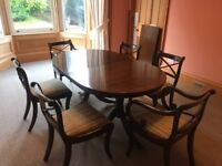 Beautiful solid mahogany dining extending dining table with 6 chairs. Pristine condition.
