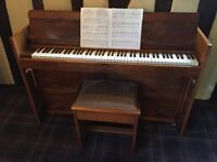 Evans compact upright piano in beautiful burr walnut finish with matching piano stool.