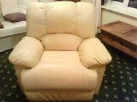Two cream leather reclining leather seats from a smoke free home