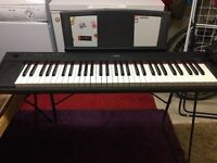 Yamaha NP11 electric keyboard piano with stand and foot pedal