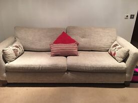 Four seater sofa with matching cushions, 8ft, very good condition. Silvery grey patterned.