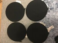 4x black circular chair cushions